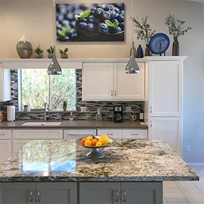lovely kitchen with marble counter tops.