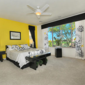 bed room with yellow wall.